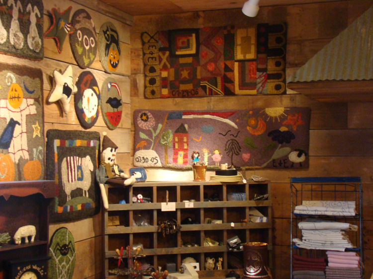 We are a primitive rug hooking shop located in rural NE Iowa. Our shelves  are loaded with woolens both